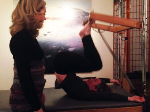Gwynne and student on reformer